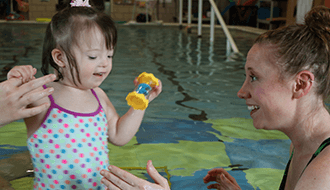 Young Patient in Therapy Pool with Therapist